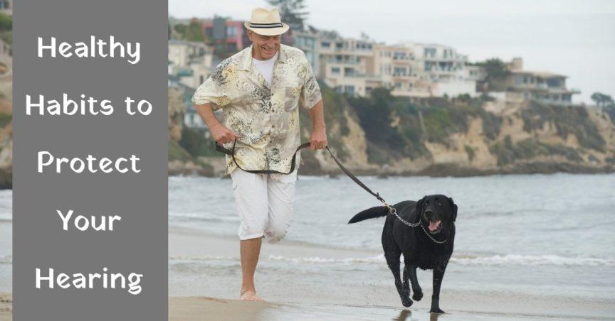 man runs with dog on beach